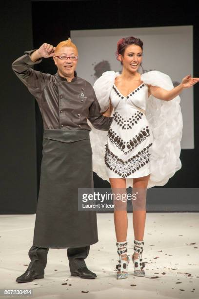 Japanese chocolatier Hironobu Tsujiguchi and Miss France 2012 Delphine Wespiser walk the Runway during 'Le Defile des Robes en Chocolats' during the...