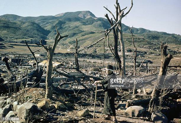 Japanese citizen walks through the damaged lands of Nagasaki, two months after the atomic bomb was dropped over the city. | Location: Nagasaki, Japan.