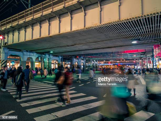 Japanese City Life at Night, Blurred Motion of People Crossing the Crossroad in front of Ueno Station and Ameya-Yokocho