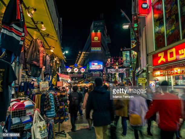 Japanese City Life at Night, Blurred Motion of People Walking Along Crowded Shopping Alley, Ameya-Yokocho