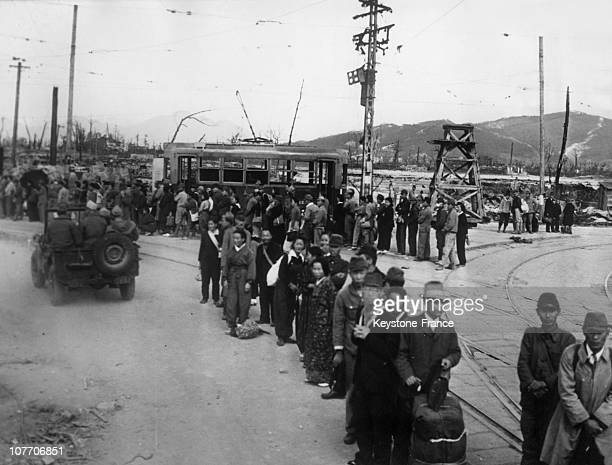 Japanese Civilians And Soldiers Waiting For The Few Bus Still Circulating In The City On The Left Some Officers Of The 5Th American Fleet Reviewing...
