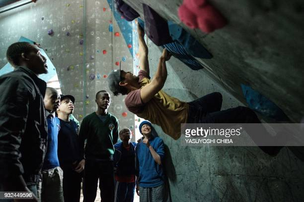 Japanese climber Naoya Suzuki demonstrates bouldering on the artificial climbing wall during a weeklong free climbing training for visually impaired...