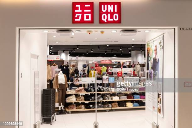 Japanese clothing brand Uniqlo logo and store in Hong Kong