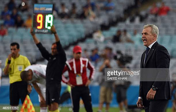 Japanese coach Javier Aguirre gives instructions to players during the quarterfinal football match between Japan and UAE at the AFC Asian Cup in...