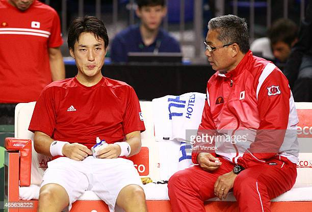 Japanese coach Minoru Ueda talks to Go Soeda of Japan during their Davis Cup match against Vasek Pospisil of Canada March 8 2015 in Vancouver British...