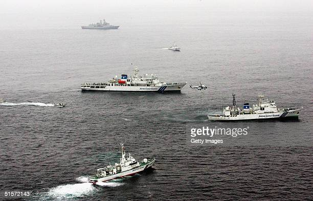 Japanese coast guard ships and helicopters in action during a multi-national exercise aimed at intercepting weapons of mass destruction at sea,...