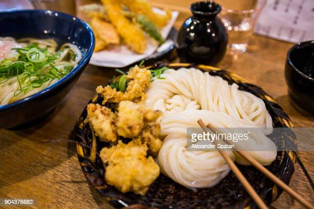 Japanese cold udon noodles with chicken on a side