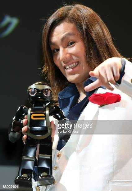 Japanese commedian Eikou Kano holds Robo Garage's Chroino during the Robo_Japan 2008 Press Preview at Pacifico Yokohama on October 10 2008 in...