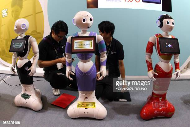 Japanese communication giant Softbank's humanoid robot Peppers for business use are displayed at Softbank's twoday convention Softbank World in Tokyo...