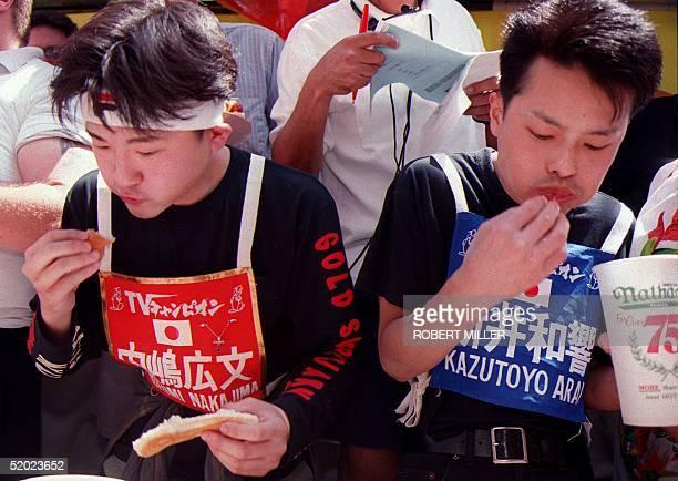 Japanese competitors Hirofumi Nakajima and Kazutoyo Arai take part in the Annual Nathan's Hot Dog Eating Championship on Coney Island NY 04 July...