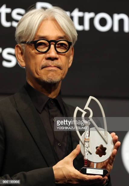 japanese composer ryuichi sakamoto a member of the yellow magic orchestra displays a special fountain pen - Ryuichi Sakamoto Merry Christmas Mr Lawrence
