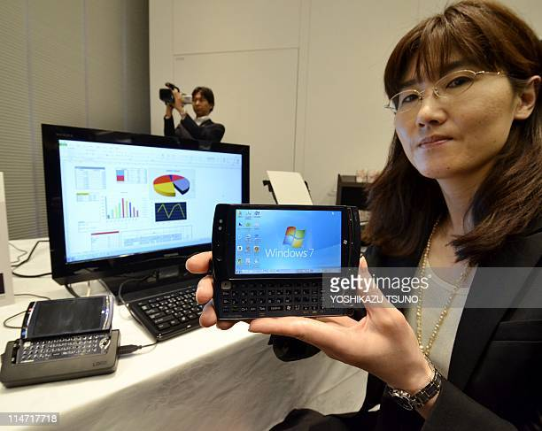 """Japanese computer giant Fujitsu employee displays the world's smallest Windows 7 computer """"FMV Loox F-07C"""", equipped with Intel's Atom processor on..."""