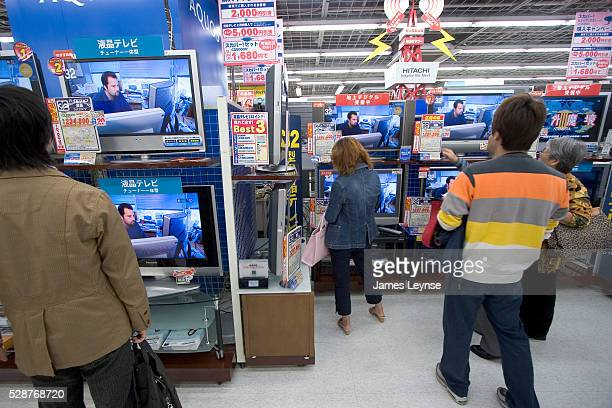 Japanese consumers looking at flat screen televisions at Bic Camera, an electronics and photo department store in Tokyo.