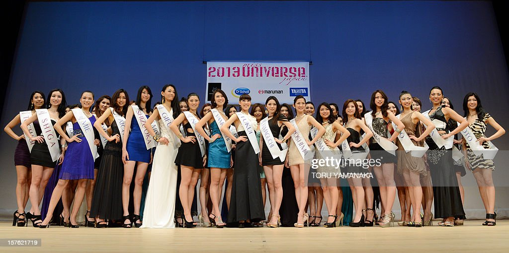 Japanese contestants from 44 prefectures pose for photographers during a press event in Tokyo on December 5, 2012. One woman will be chosen to represent Japan on March 4, 2013 for the 2013 Miss Universe beauty pageant. AFP PHOTO/Toru YAMANAKA