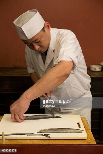 Japanese cook preparing fish