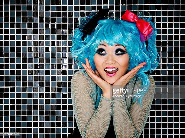 japanese cosplay woman posing in front of multicoloured tiles - anime stock photos and pictures