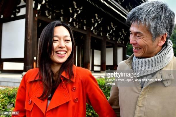 Japanese Couple Chatting in Intimate Mood at Tofuku-ji Temple, Kyoto