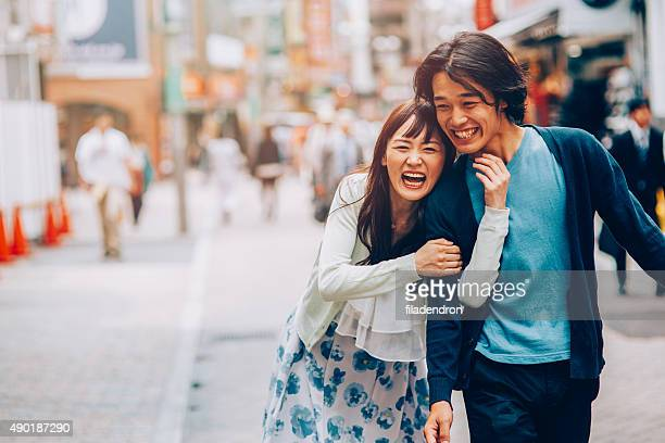 Japanese couple having fun outside int he city