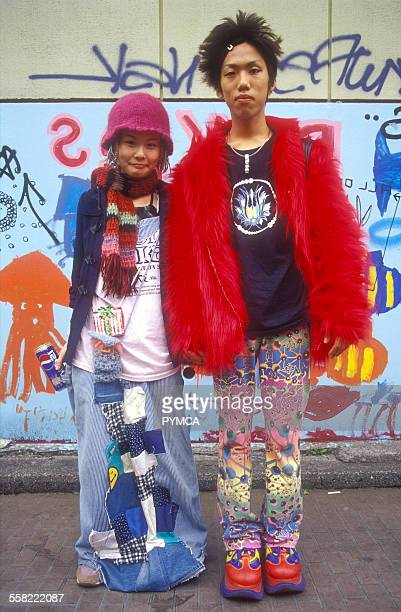 A Japanese couple in Harajuku Tokyo wearing a patchwork skirt and brightlycoloured clothes trainers and platforms Japan 2003