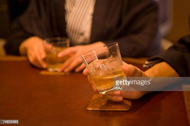 Japanese couple in Yukata drinking at the hotel bar, front view, side view, differential focus, Japan
