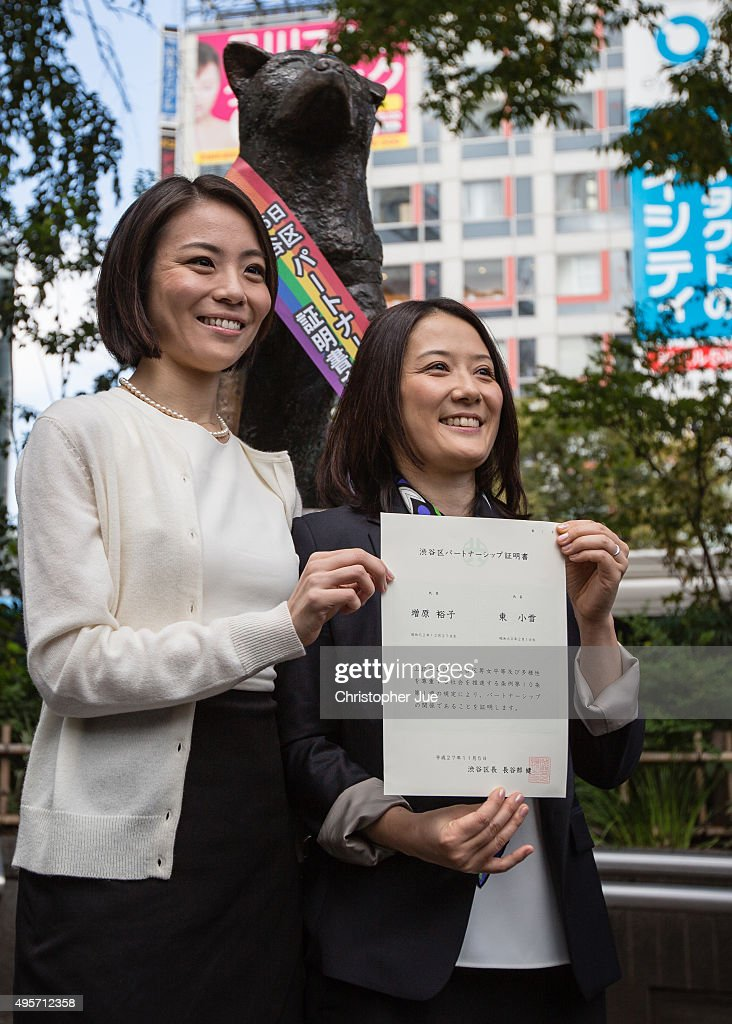 Japanese couple Koyuki Higashi (L) and Hiroko Masuhara (R) celebrate as hold up their same-sex marriage certificate in front of Shibuya's Hachiko statue on November 5, 2015 in Tokyo, Japan. Shibuya Ward in the Tokyo became the first local government in Japan to issue the official certificates recognizing same-sex partnerships.