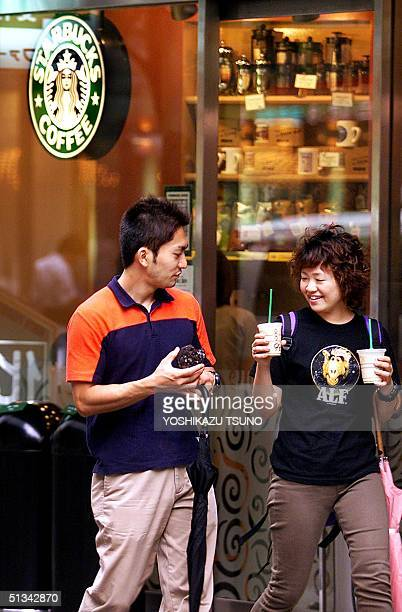 Japanese couple leave a Starbucks coffee shop in Tokyo 10 September 2001 Starbucks Coffee Japan Ltd was tightlipped on a report 10 September the...