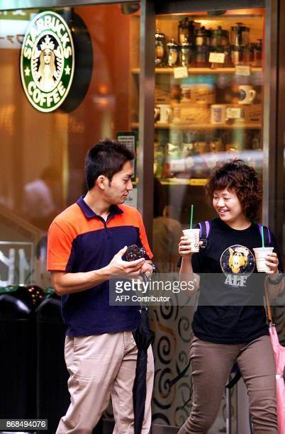 A Japanese couple leave a Starbucks coffee shop in Tokyo 10 September 2001 Starbucks Coffee Japan Ltd was tightlipped on a report 10 September the...