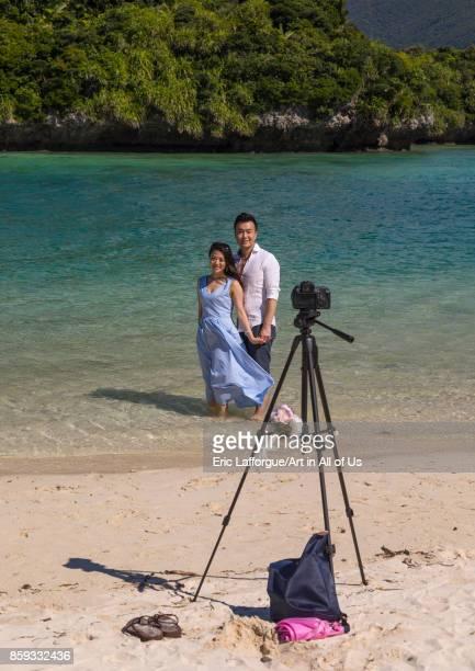 Japanese couple posing in the tropical lagoon with clear blue water in Kabira bay Yaeyama Islands Ishigaki Japan on August 28 2017 in Ishigaki Japan