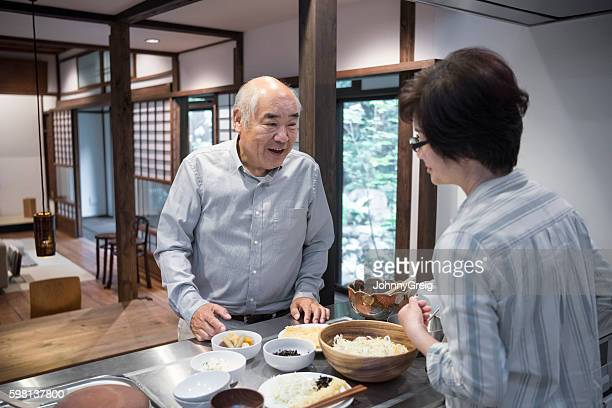 Japanese couple preparing food together at home