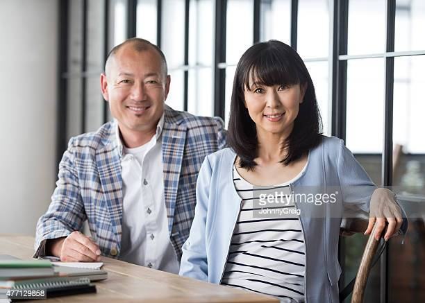 Japanese couple sitting at table