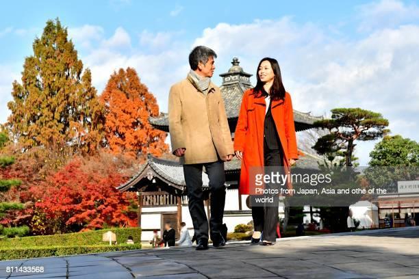 Japanese Couple Walking at Tofuku-ji, Kyoto, on Fine Autumn Day