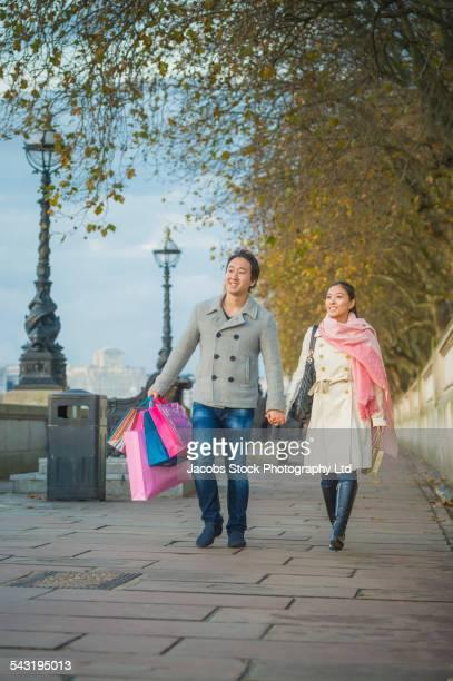 Japanese couple walking on sidewalk