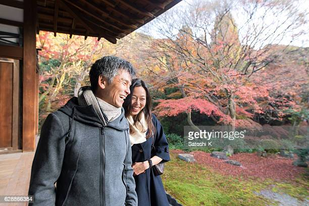 Japanese couple walking together in Tofukuji temple, Kyoto in autumn