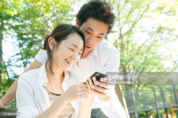 Japanese couple watching smartphone
