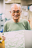 Japanese craftsman is showing his craft work