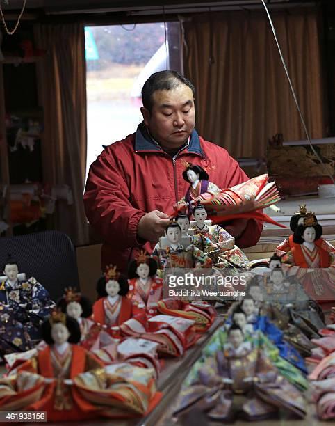 Japanese craftsman Takeshi Itou makes dolls ahead of Hinamatsuri at Kishimoto Ningyou doll workshop on January 22 2015 in Ono Japan Hinamatsuri or...