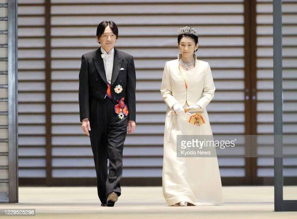 Japanese Crown Prince Fumihito and Crown Princess Kiko are pictured leaving the Imperial Palace in Tokyo on Nov. 8 following day-long rituals for his...