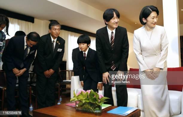 Japanese Crown Prince Fumihito Crown Princess Kiko and their 12yearold son Prince Hisahito meet with Japan International Cooperation Agency staff...