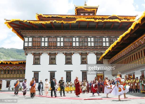 Japanese Crown Prince Fumihito Crown Princess Kiko and their 12yearold son Prince Hisahito visit a building that houses the Bhutanese king's office...