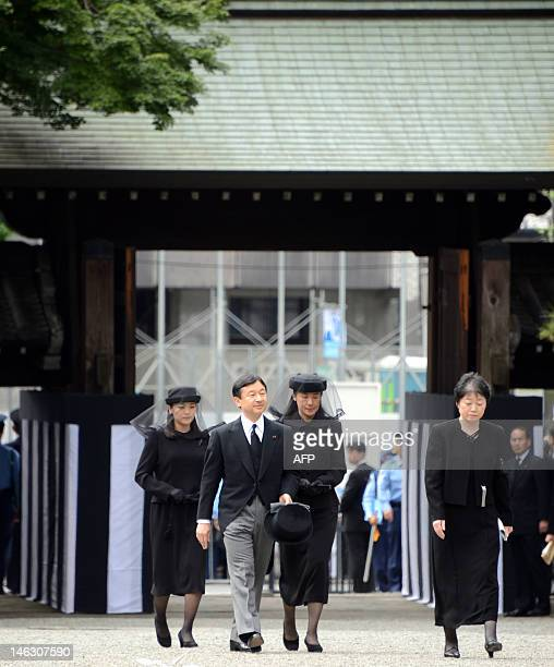 Japanese Crown Prince Naruhito and Crown Princess Masako arrive at the Imperial Graveyard of Toshimagaoka to attend the funeral of the late Prince...