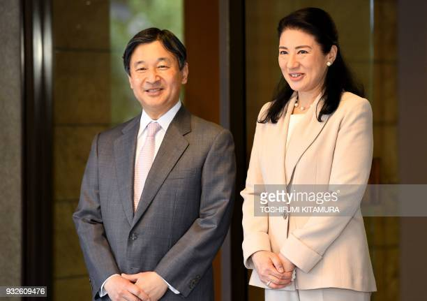 Japanese Crown Prince Naruhito and Crown Princess Masako stand at the entrance of Togu Palace as the crown prince prepares to depart for Brazil in...