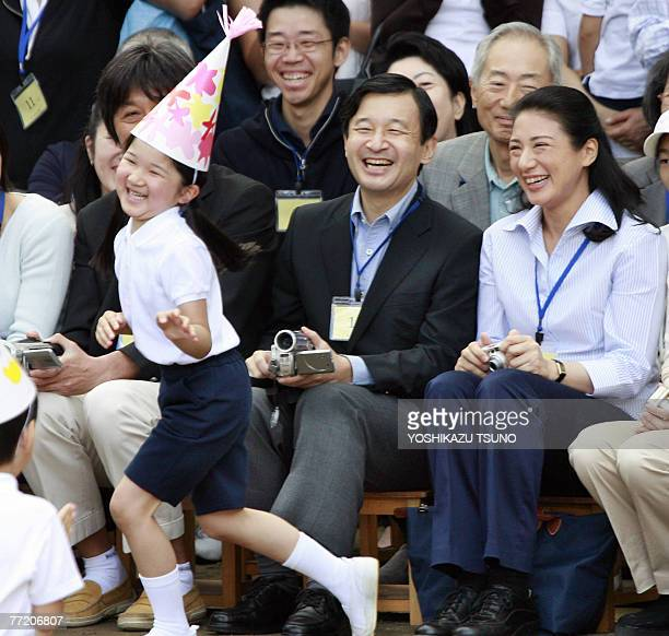 Japanese Crown Prince Naruhito and Crown Princess Masako watch their daughter Princess Aiko perform during her kindergarten athletics festival in...