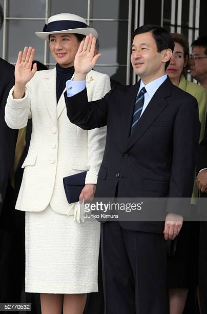 Japanese Crown Prince Naruhito and Crown Princess Masako wave at the airplane with Emperor Akihito and Empress Michiko on board upon seeing them off...