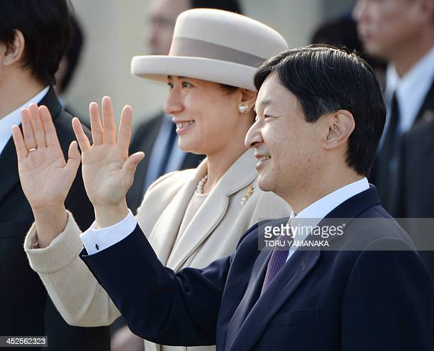 Japanese Crown Prince Naruhito and Crown Princess Masako wave to see off a plane on which Emperor Akihito and Empress Michiko are aboard before they...