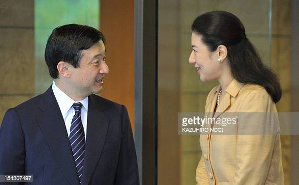 Japanese Crown Prince Naruhito and his wife Crown Princess Masako speak prior to his departure to Luxembourg at Togu Palace in Tokyo on October 18...