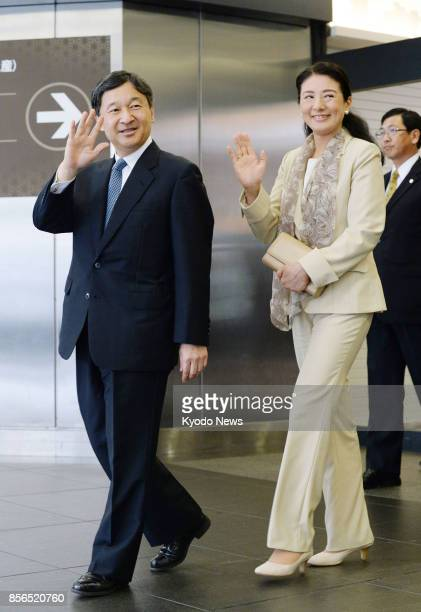 Japanese Crown Prince Naruhito and his wife Crown Princess Masako wave to a crowd upon arrival at JR Kyoto Station in the western Japanese city on...