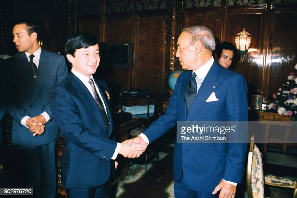 Japanese Crown Prince Naruhito and King Hassan II of Morocco shake hands prior to their meeting at the royal palace on September 12 1991 in Rabat...