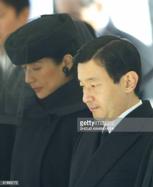 Japanese Crown Prince Naruhito and Princess Masako contemplate as they attend the funeral of the late Princess Kikuko at the Toshimagaoka cemetery in...