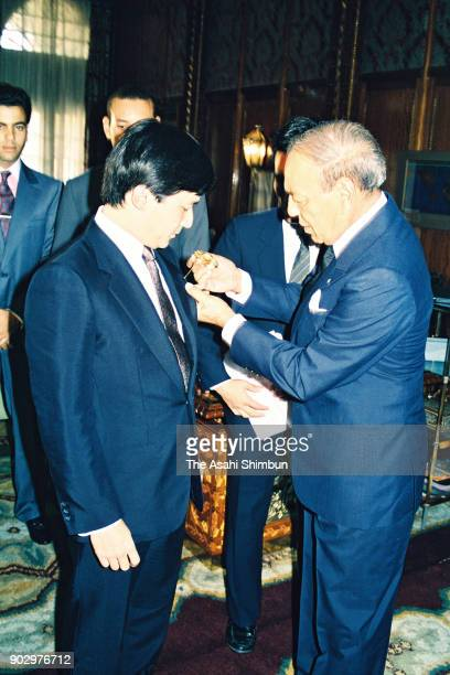Japanese Crown Prince Naruhito receives the medal from King Hassan II of Morocco at the Royal Palace on September 12 1991 in flight