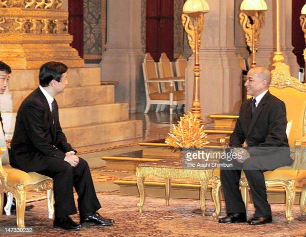 Japanese Crown Prince Naruhito talks to Cambodian King Norodom Sihamoni during their meeting at the Royal Palace on June 27 2012 in Phnom Penh...